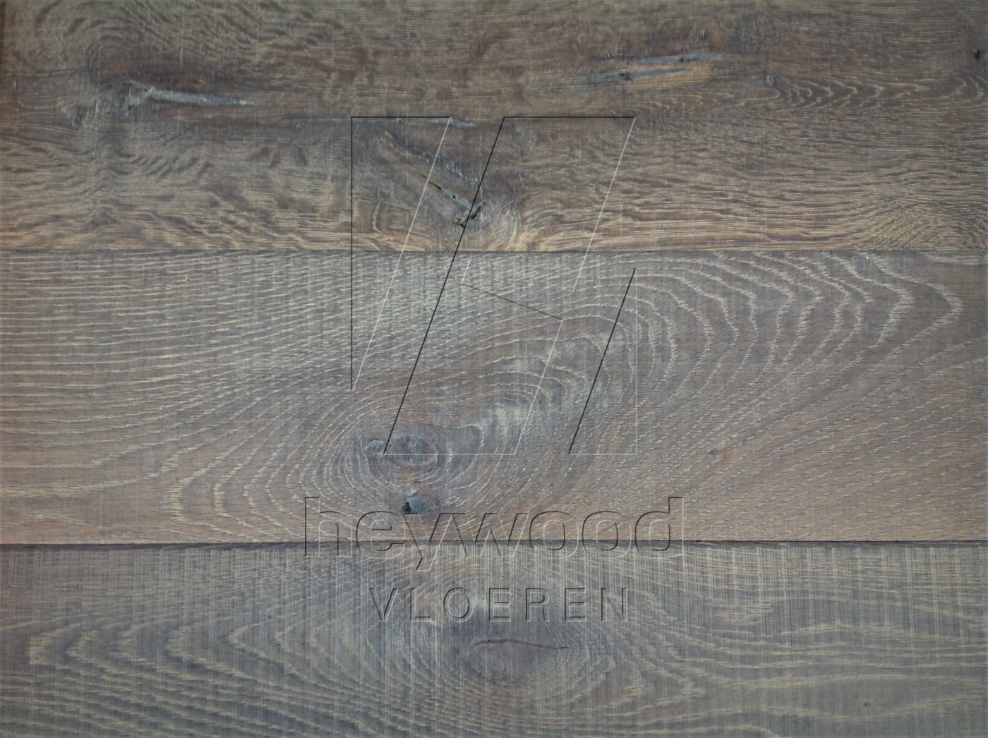 Gran Paradiso in Aged Knotting Hill Surface of Aged Hardwood Floors